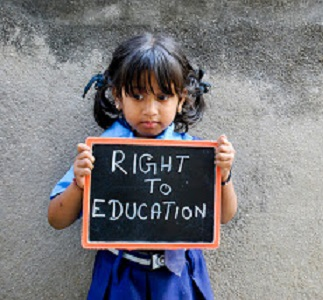 "Young child holding a sign that reads ""Right to education\"""
